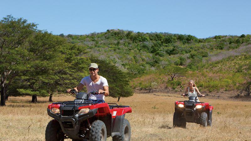 Couple exploring on ATVs