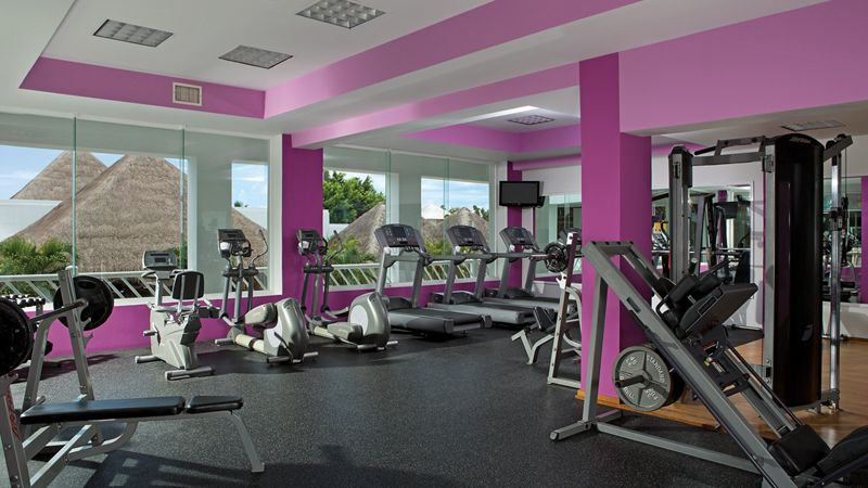 fitness center with weights, ellipticals, treadmills and workout equipment