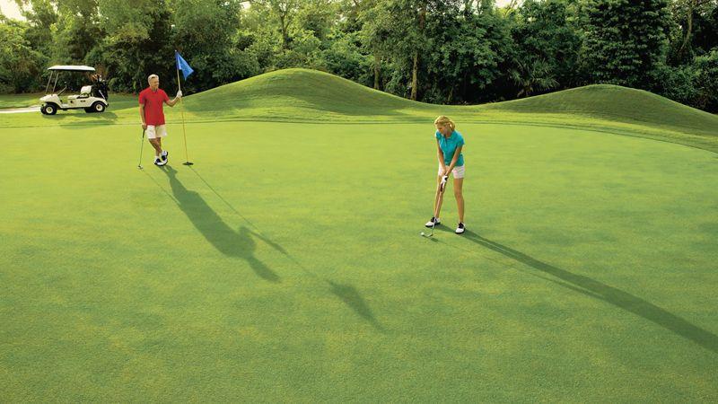 Couple golfing