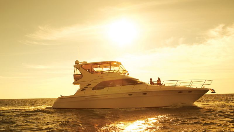 Yacht sailing in the sunset