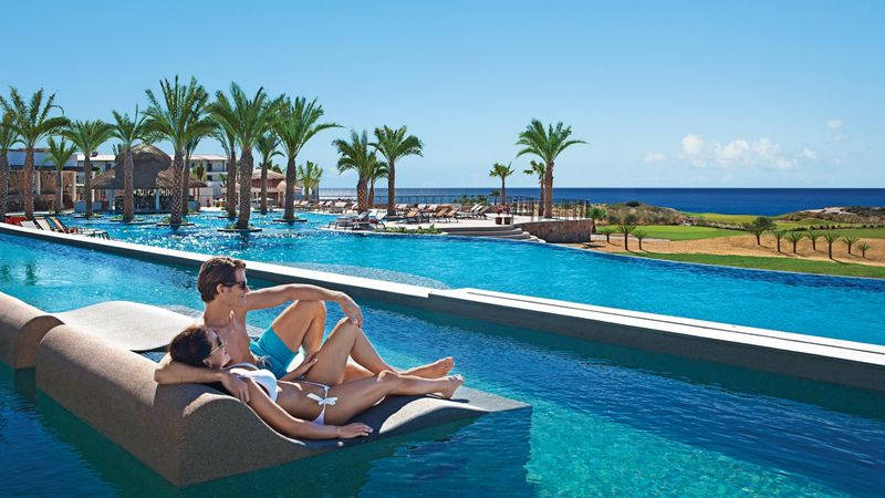 couple relaxing in luxury resort pool