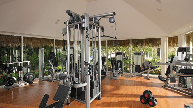 fitness center with weights and workout equipment